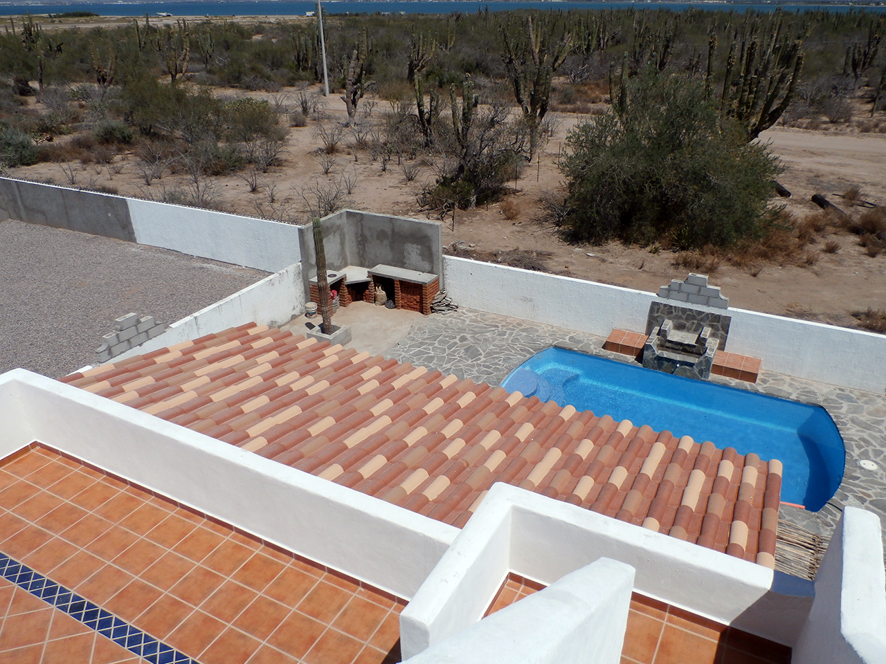 View of Pool & Bar from Deck at Divers Inn MX Bed & Breakfast in La Paz, Mexico